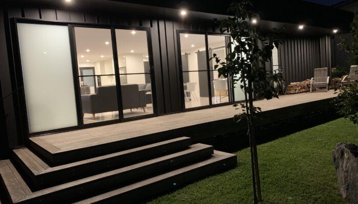 Black01 exterior front at night
